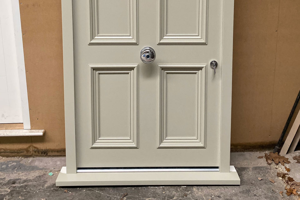 Wooden painted front door with traditional door furniture for a property in Knutsford Cheshire