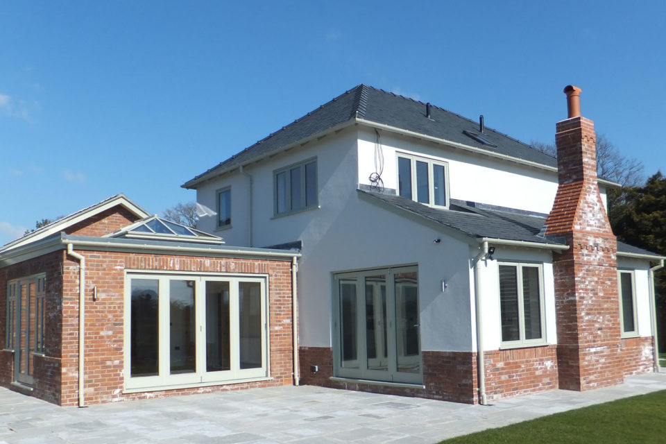 Accoya bi-folding doors, casement windows, French doors and roof lantern with green paint finish