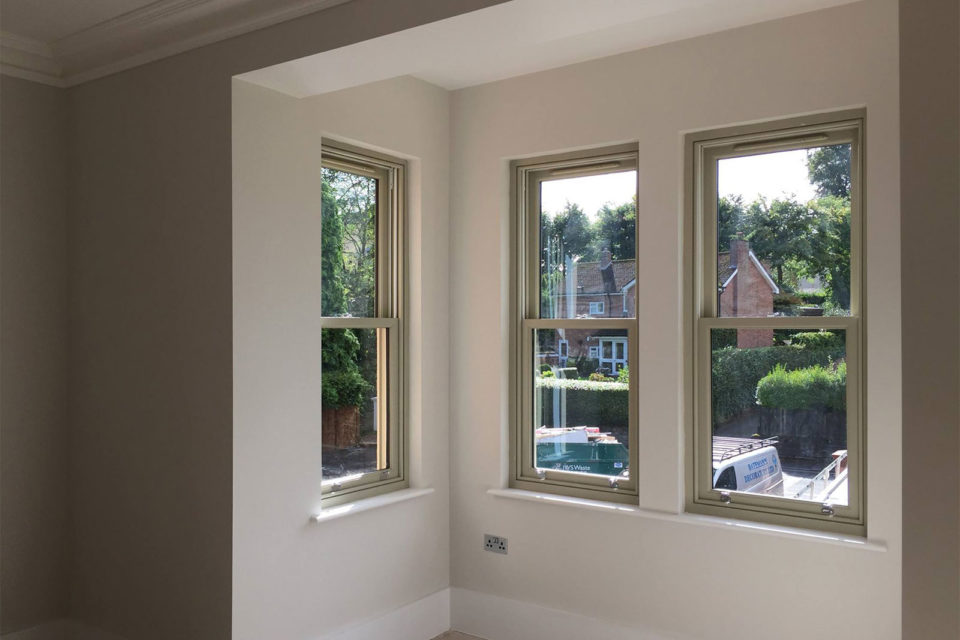 internal view of Accoya spiral balance sliding sash windows pre finished in French Gray