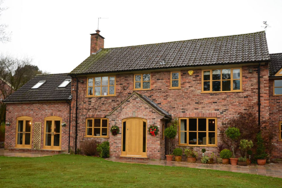Curved Accoya casement windows, French doors and solid panel front door