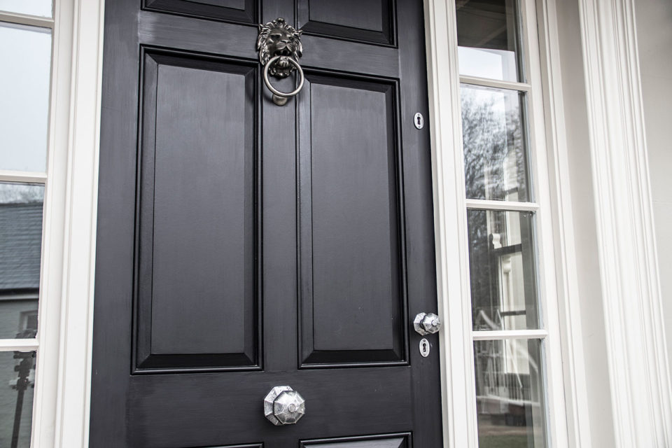 From The Anvil period front door furniture in pewter finish on black front door