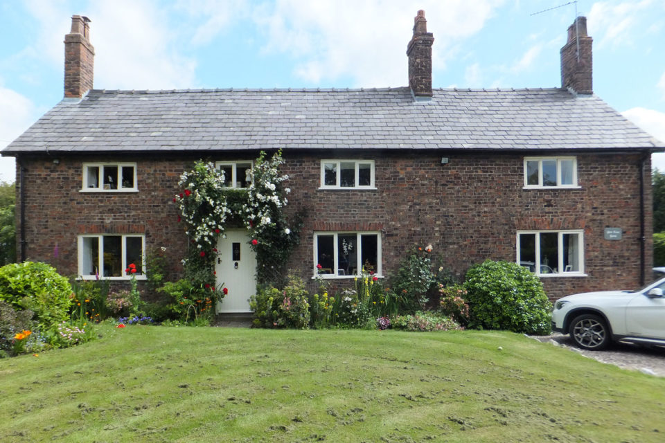 before shot of casement windows and door renovation project on listed farmhouse property