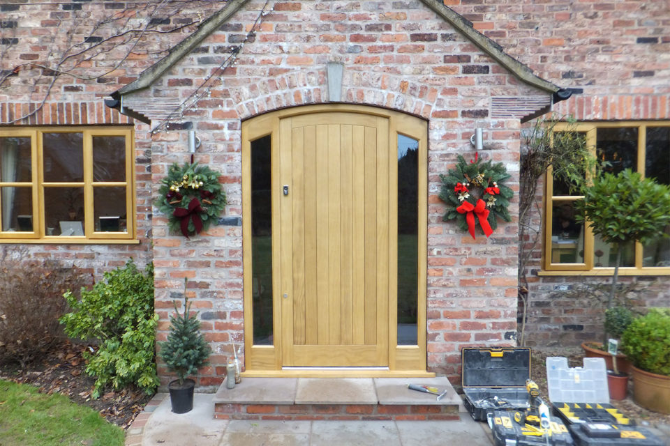 curved Accoya solid panel front door in a natural finish
