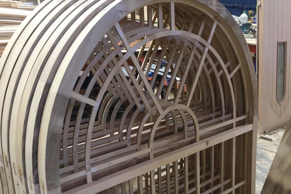 curved timber sliding sash window during manufacture