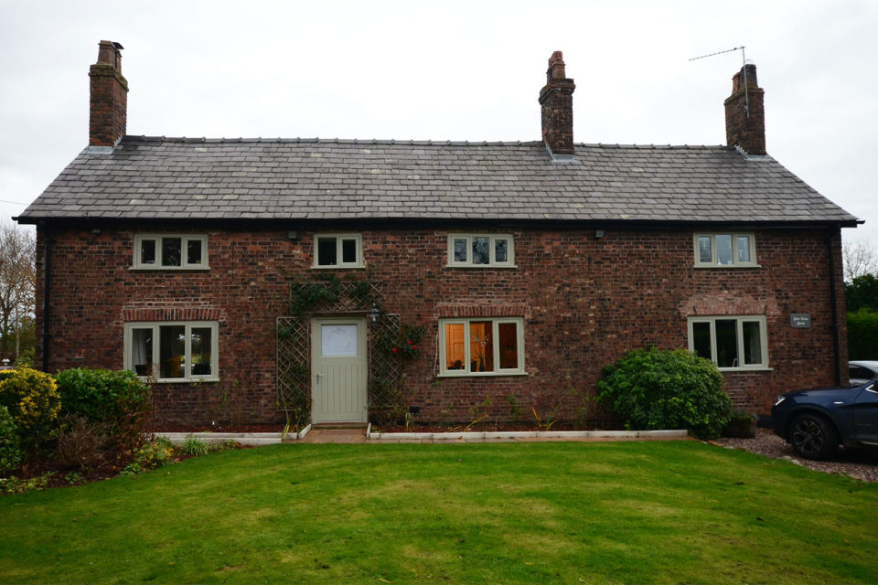 green casement windows and door on listed farmhouse property
