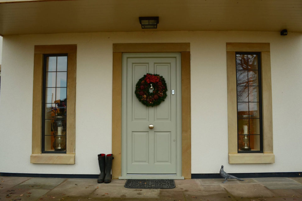 green hardwood panel front door