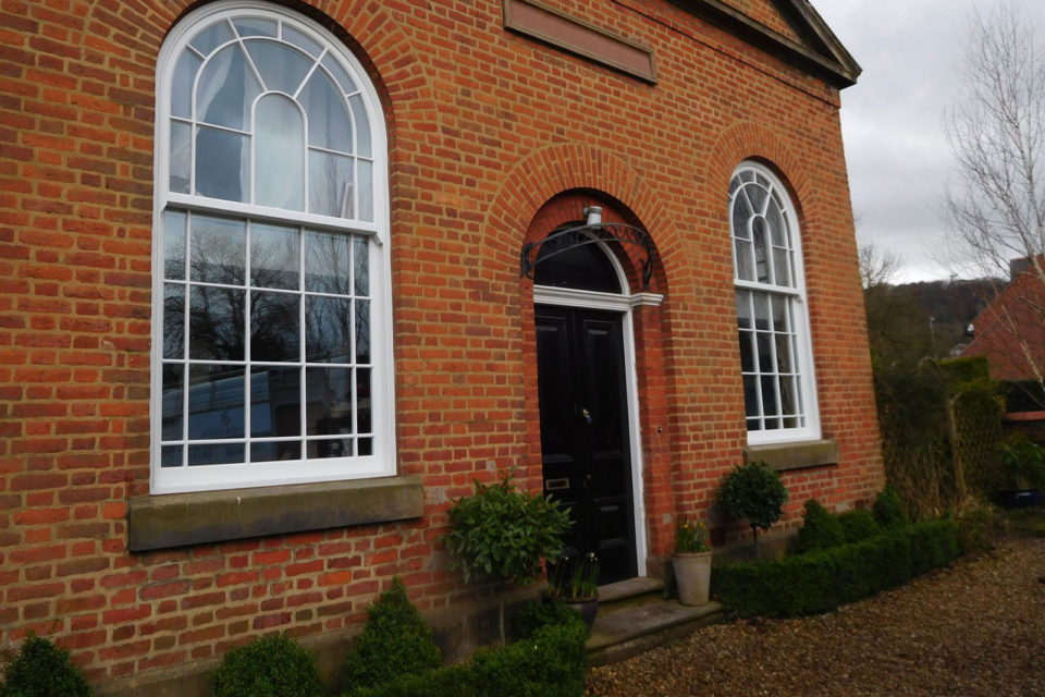 period double height curved Accoya sliding sash windows with glazing bar detail