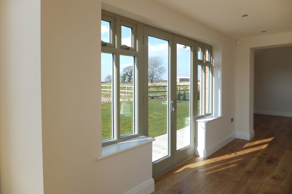 timber french doors and casement windows with multi point locking system