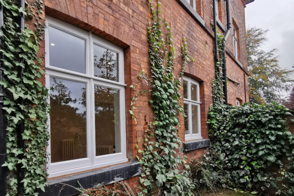 Traditional Victorian mouldings on wooden casement windows finished in clean white