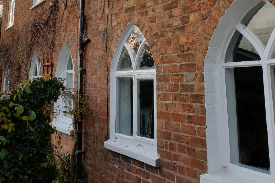 gothic style pointed arch timber windows before replacement
